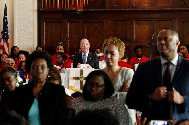 Congregants turn their backs on Bloomberg as he speaks at Alabama church