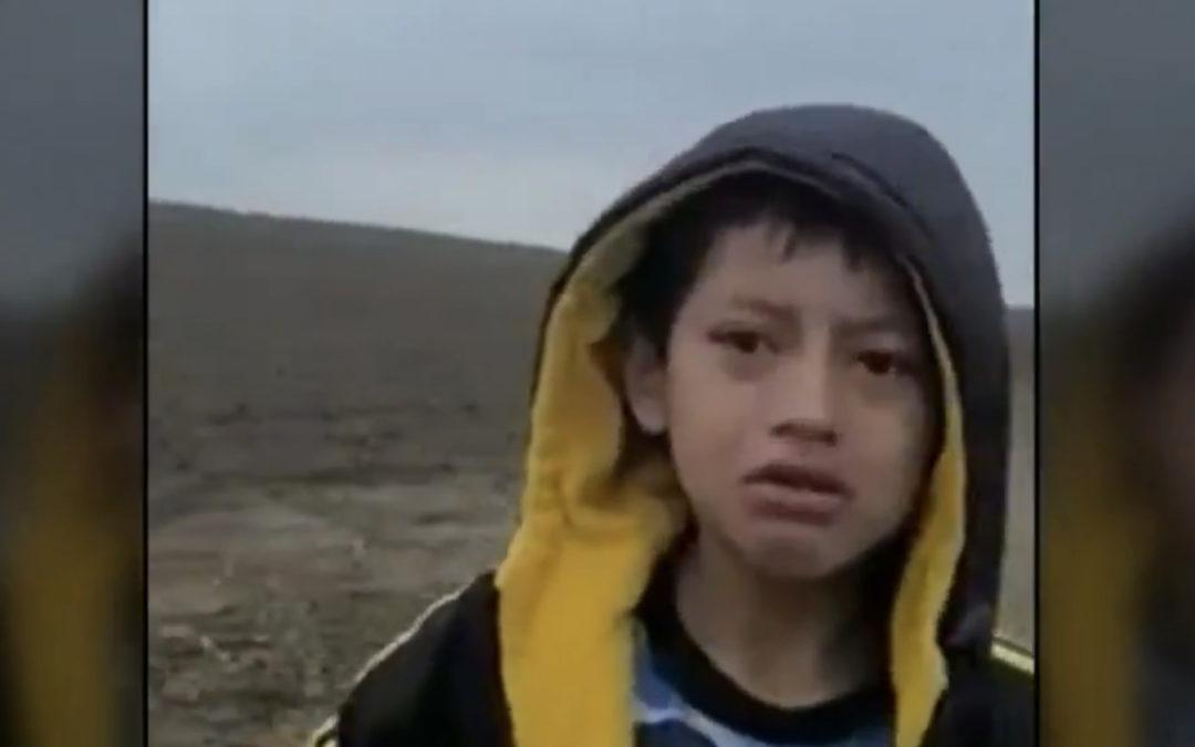 A heartbreaking video shows a migrant boy abandoned at the border